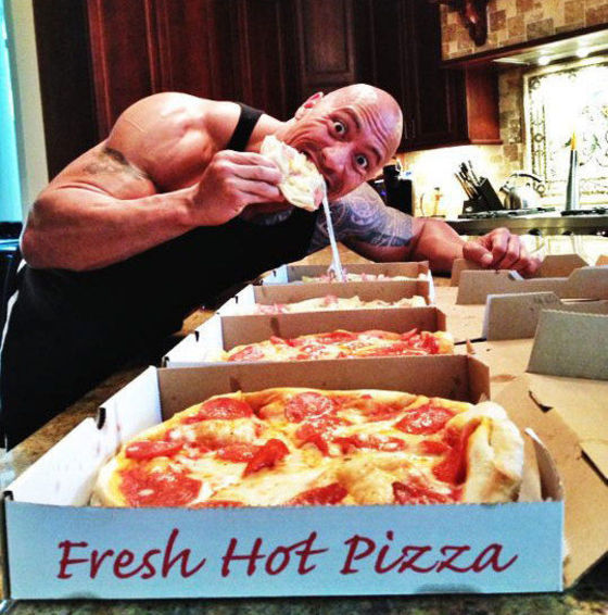 1350578628_dwayne-johnson-wolfing-down-pizza-for-fast-six.jpg